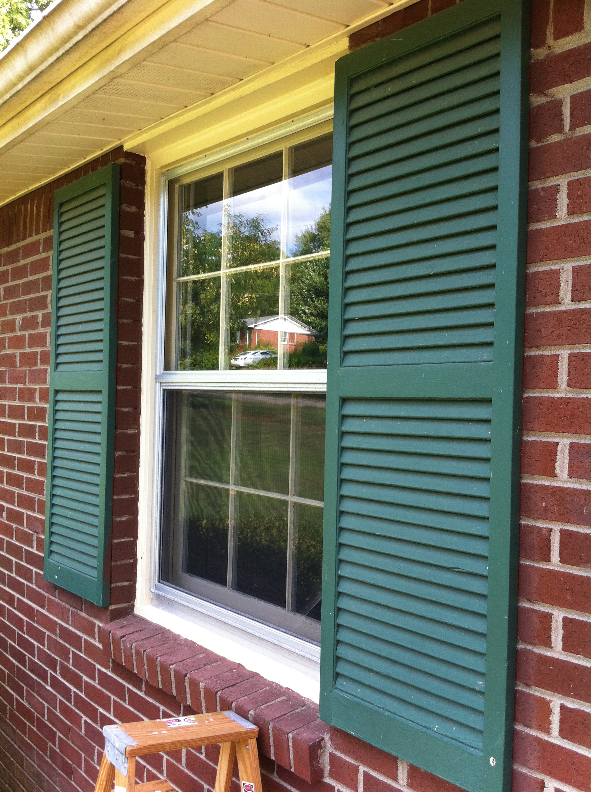 Green siding black shutters our venice in pa light gray for Brick houses without shutters